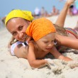Stock Photo: Little girl with her mother at the beach
