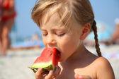 Cute little girl eating watermelon in summertime — Stock Photo