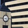 Foto de Stock  : Clock Tower next to hospital