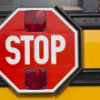 Stop sign on yellow school bus — Stock Photo