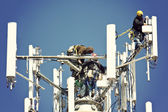 Crew installing antennas — Stock Photo