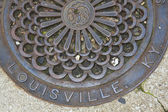 Louisville - manhole cover — Stock Photo
