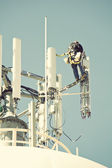 Crew working on the cell tower — Stock Photo