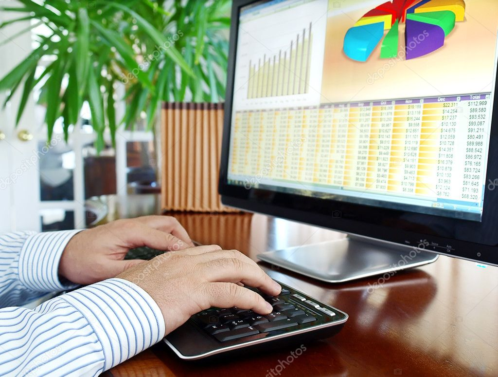 Male hands on the keyboard in front of computer screen with financial data and charts — Stock Photo #5815127