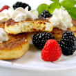 Foto de Stock  : Curd pancakes with berries .