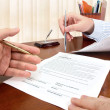 Stock Photo: Signing a contract.