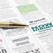 Stock Photo: Pen on newspaper
