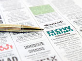 Pen on the newspaper — Stock Photo