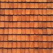 Old red tile roof. A background — Stock Photo