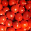 Fresh tomatoes on street market for sale - Stock Photo