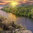 Landscape with rock and river on sunset background — Stock Photo