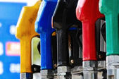Different types of fuel dispensers at filling station — Stock Photo