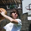 Basketball Player with Blurred Background - Stock Photo