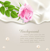 Elegant holiday vector background with silk, pearls and a pink r — Stock Vector