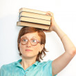 Calm and serious woman with open book on head — Stock Photo