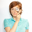 Woman with magnifier lens on eye — Stock Photo #6026885