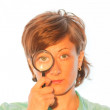 Woman with magnifier lens on eye — Stock Photo