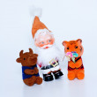 Toy bull and tiger and santa claus — Stock Photo
