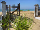 Gate on the beach — Stock fotografie