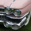 Stock Photo: Front side of a pink classic car