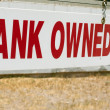 Bank owned real estate sign — Stock Photo