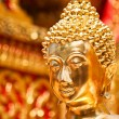Royalty-Free Stock Photo: Gold face of Buddha statue in Doi Suthep temple, Chiang Mai, Thailand.