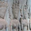 Detail of stone Apsara (Devata) carving in Angkor Wat complex — Stock Photo