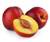 Two nectarines with half — Stok fotoğraf