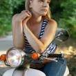 Girl on a scooter — Stock Photo