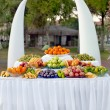 Fruit table for the buffet table at the festival - Stock Photo