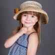 Little girl in a dress with a straw hat — Stock Photo #6180646