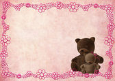 Teddy bear greeting card with pink flowers — Stock Photo