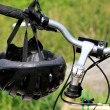 Helmet on handlebar — Stock Photo