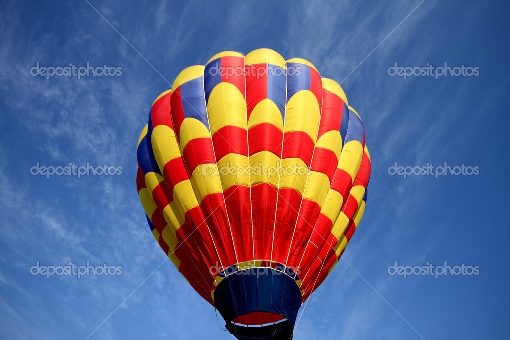 Hot air balloon on blue background with red blue and yellow highlights. — Stock Photo #6442524