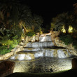 Falls and fountains at night. - Stock Photo