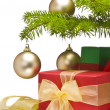 Stock Photo: Presents under decorated Christmas tree