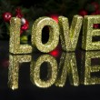In capital letter written love, glitter effect - Stock Photo