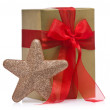 Present decorated with a glitter star — Stock Photo