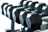 Weights of a gym diffrent sizes and weights — Stock Photo