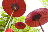 Three red umbrella in a outdoor setting — Foto de Stock