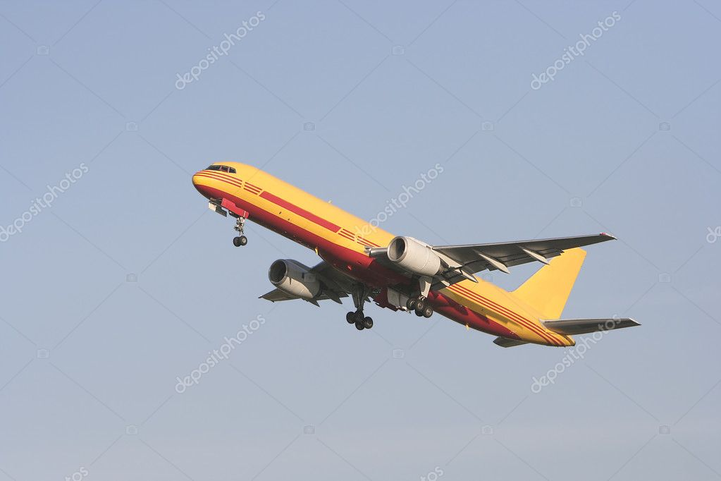Yellow airliner taking off in a blue sky — Stock Photo #5488894