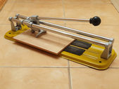 Construction works- ceramic tile cutter with tile. — Stock Photo