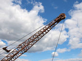 Silhouette of a crane boom. — Stock Photo