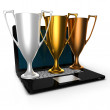 3d gold silver bronze cups on laptop — Stock Photo