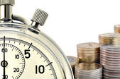 Stopwatch and coins — Stock Photo