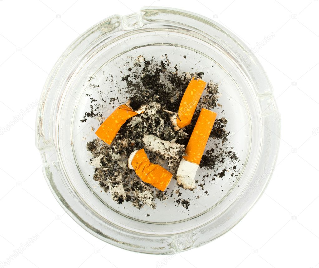 Top view of a glass ashtray with stubbed out cigarette butts  — Stock Photo #6023257