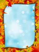 Autumn leaves with background of blue sky. EPS 8 — Stock Vector