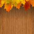Royalty-Free Stock Vector Image: Fall leaves making border on wooden. EPS 8