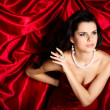 A beautiful young woman is in red clothes — ストック写真