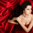 A beautiful young woman is in red clothes — Foto Stock